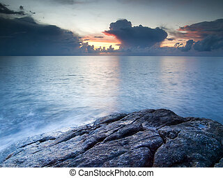 Beautiful seascape. Sea and rock at the sunset