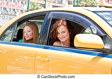 Two women in a taxi