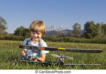 Happy young boy and his RC plane - Smilling happy young boy...