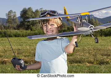 The little villain and new RC plane - Smiling happy young...