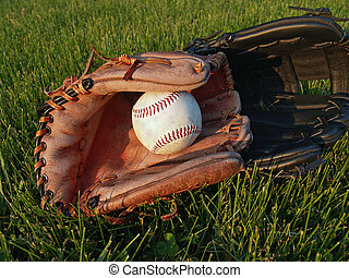 After Baseball Game - An old baseball & two leather gloves...