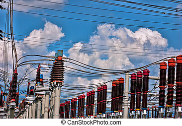 Transformer station with cable, blue sky and clouds