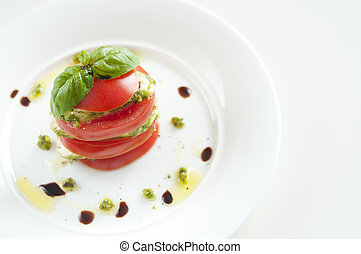 Mozzarella with tomato and basil covered with pistachio...