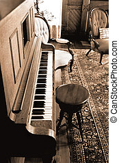 Old Piano - Antique piano with chair in a sepia toned parlor...