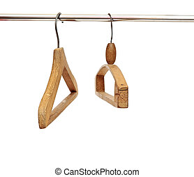 Coat hangers on clothes a rail against white