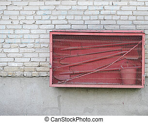 Fire fighting equipment on brick wall