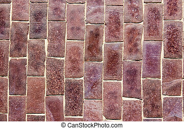 Purple mosaic background - Close up of a wall covered in...