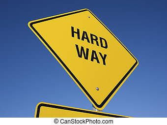 Hard Way road sign with deep blue sky background Contains...
