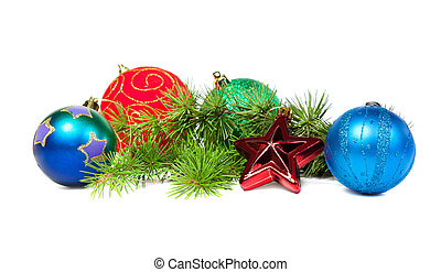Christmas decorations and fir branch isolated on white...