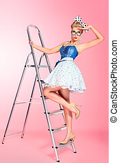 step by step - Beautiful young woman with pin-up make-up and...
