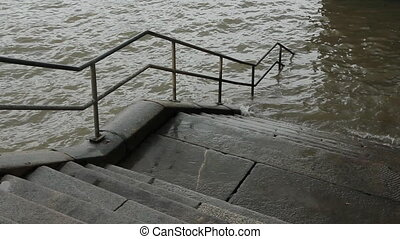 Thames Steps. - Stone steps with railing leading into the...