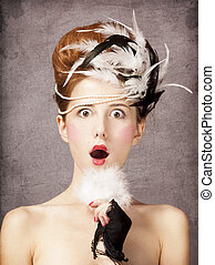Surprised redhead girl with Rococo hair style at vintage...
