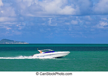 Speed boat sailing in the summer sea in Thailand