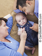 Mixed Race Family Playing on the Blanket