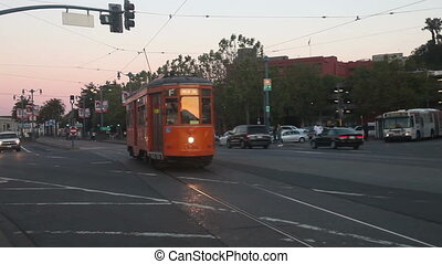 Tram runs toward camera