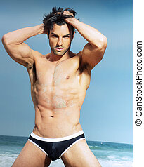 Sexy male model in fashion swimwear posing - Sexy man posing...