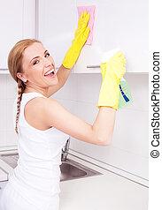 young housewife - beautiful young housewife wearing gloves...