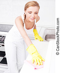 housewife cleaning furniture - beautiful young housewife...