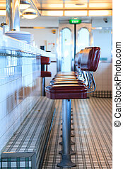 Retro Diner - An empty diner awaits its first customers of...