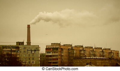 Factory pipe steams in the city - Sepia toned image of a...