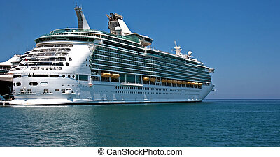 Large cruise ship at anchor on a clear summer day