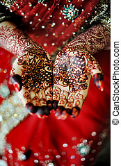 Indian bride's hand - Beautiful henna tattoo in an Indian...