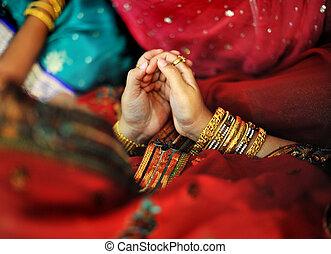 Indian Muslim prayer in red sari