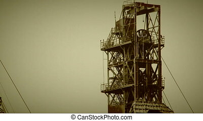Industrial derricks - Working industrial derricks on a grey...
