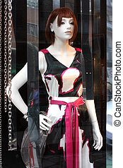 Charming dress - Beautiful female mannequin in a...