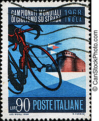 Cyclists and Imola Castle - ITALY - CRICA 1968: A stamp...