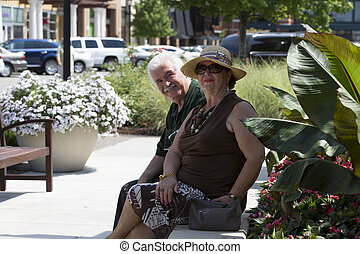 Retirees - Older husband and wife enjoying their time out...
