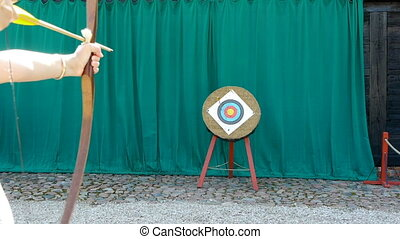 HD - Woman engaged in archery