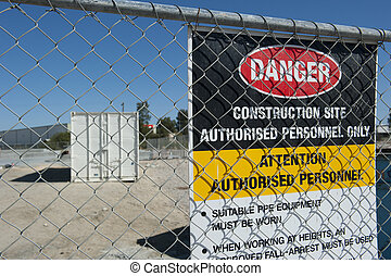 Trespassing sign construction site - Fenced off industrial...