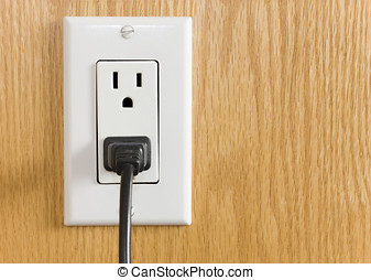 Electrical outlet with black power cord - Electrical outlet...