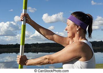 Senior woman exercising - A senior woman is doing exercises...