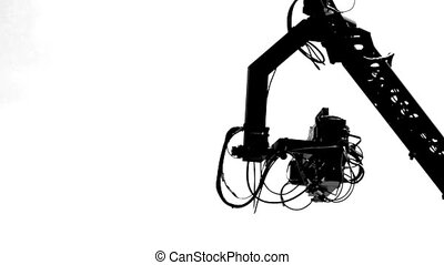 HD - Silhouette. TV camera crane