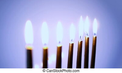 HD - Moving focus on candles. blue