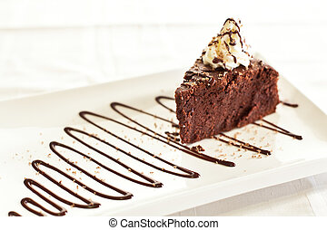 Chocolate Cake - Isolated chocolate cake slice with...
