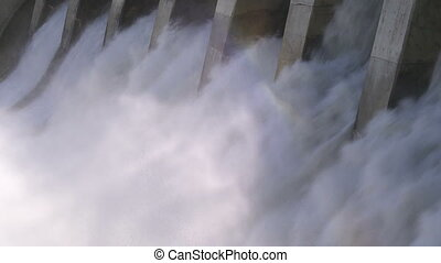 Hydro Dam Rainbow 01 - A hydroelectric dam with spillways in...