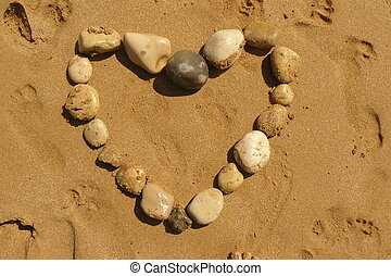 Love heart from pebbles on a beach