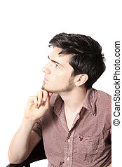 Thinking man - Profile of young man with his fist to chin as...