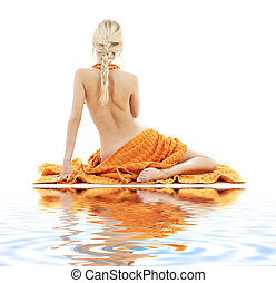 beautiful lady with orange towels on white sand - picture of...