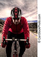 Cyclist on the road - Cyclist on road bike through a asphalt...