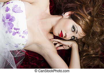 Red Hair Woman lying on her sofa looking at the camera