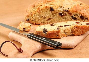 Loaf of Bread - Sliced loaf of Irish Soda Bread on a Cutting...