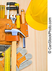 tools in belt on boards