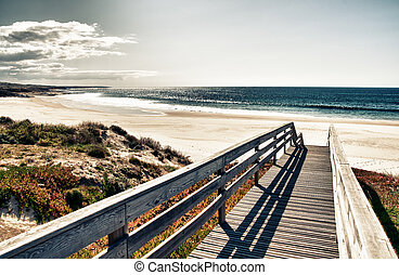Super image of a boardwalk to the beach, really nice bleach...