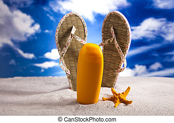 Flip flops on the beach, suntan