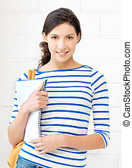 happy and smiling teenage girl with big notepad - picture of...