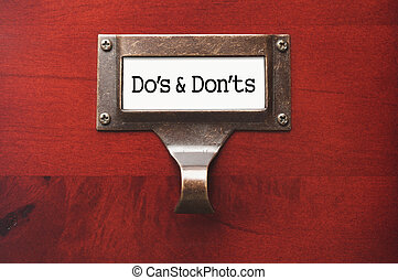Lustrous Wooden Cabinet with Do's and Don'ts File Label in...